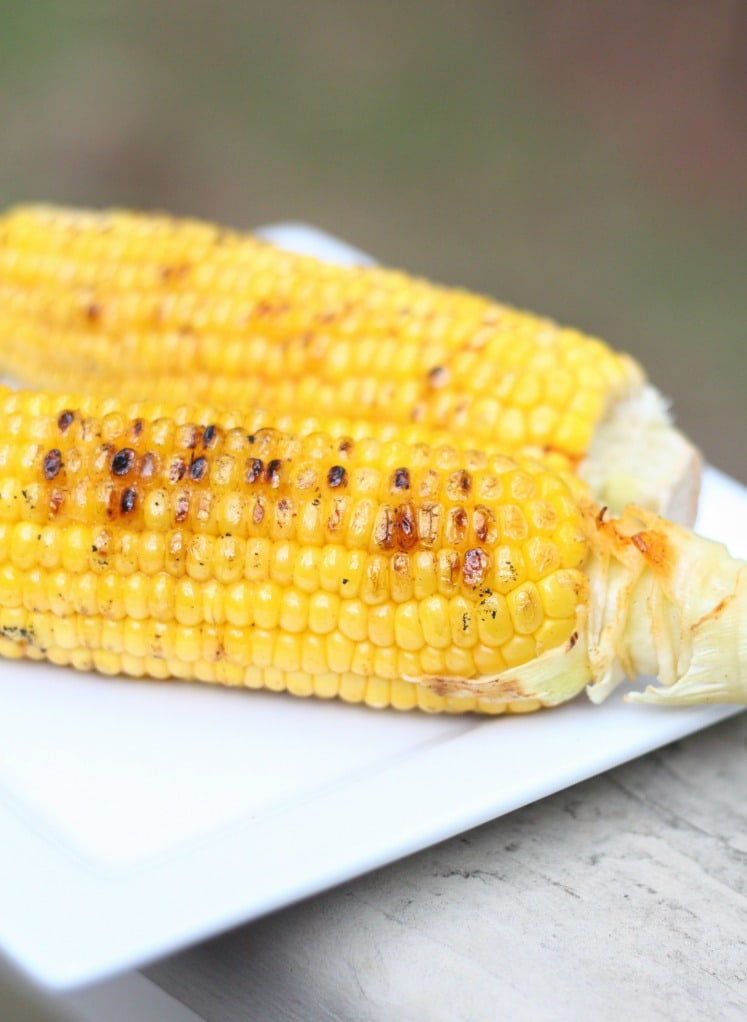 This grilled corn recipe is packed with flavor! This is the perfect side dish for those summer bbq parties. Make sure to give this grilled corn recipe a try!